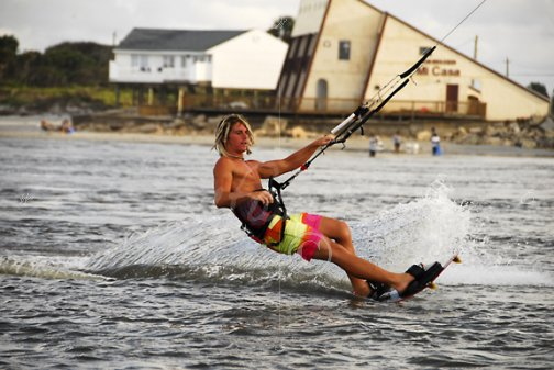 Kite surfer cuts the water