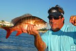 Angler with mutton snapper