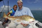Father and daughter, bull redfish