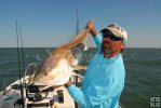 Captain Curtiss Cash and bull redfish