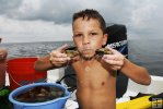 Young snorkeler with scallops
